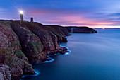 France, Cotes d'Armor, Plévenon, Cap Frehel and lighthouse at dusk