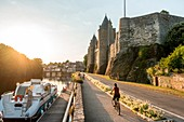 France, Morbihan, Josselin, cyclist on the towpath along the canal from Nantes to Brest