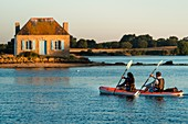 France, Morbihan, Belz, kayak on Etel ria with island of Nichtarguer in background