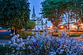 France, Morbihan, Gulf of Morbihan, Regional Natural Park of the Gulf of Morbihan, Ste. Anne of Auray, Church of St. Anne of Auray in a night of greenery