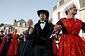 France, Morbihan, Gulf of Morbihan, Regional Natural Park of the Gulf of Morbihan, Auray, St. Goustan, parade in traditional costumes in a street with half-timbered houses