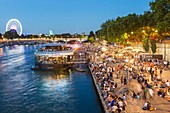 France, Paris, area listed as World Heritage by UNESCO, the New Berges at Quai d'Orsay with bar barge Flow and the Big Wheel