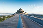 France, manche, Mont Saint Michel Bay listed as World Heritage by UNESCO, the footbridge by architect Dietmar Feichtinger and Mont Saint Michel