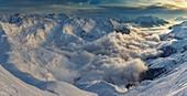France, Savoie, Beaufortain, Hauteluce, snowy landscape at sunset