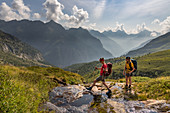 Crossing the stream, Trekking del Laghetti Alpini, Ticino, Switzerland