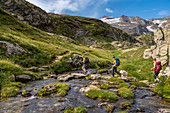 Crossing the stream in the Randinascia, 3rd day stage Trekking del Laghetti Alpini, Ticino, Switzerland