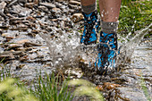 Splashing water, stream crossing, Trekking del Laghetti Alpini, Ticino, Switzerland