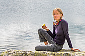 Wanderin, eating an apple, Lagho di Boden, Trekking del Laghetti Alpini, Ticino, Switzerland