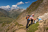 Marking work on the ascent to Passo Grandinagia, Trekking del Laghetti Alpini, Ticino, Italy