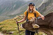 Hiker meets cow, Trekking del Laghetti Alpini, Ticino, Switzerland