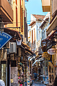Historic narrow streets with souvenir stalls in the old town of Rethymno, North Crete, Greece