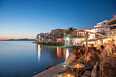 Waterfront restaurants at night in Mykonos, Greece