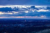 Cityscape under overcast sky at sunset