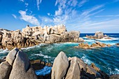France, Corse du Sud, Belvedere Campomoro, waves on rocks sculptured by the erosion