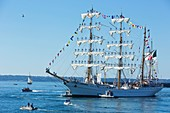 France, Finistere, Brest, Fetes maritimes internationales de Brest 2016 (International maritime feast Brest 2016), large gathering of sailing and yachting and of sailors and seafarers, the mexican three master Cuauthemoc leaving Brest with its seafarers in the topsails
