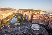 France, Alpes-Maritimes, Nice, the Promenade du Paillon, the reflecting pool of 3000 m2 and the fountains of the Place Massena, overlooking the clock tower of the former convent of brothers minors of St. Francis