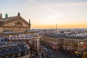France, Paris, the Opera and the Eiffel Tower at nightfall