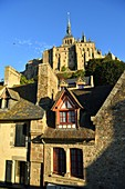 France, Manche, Mont Saint Michel Bay listed as World Heritage by UNESCO, Mont Saint Michel, half timbered houses and abbey church from the fortification walk