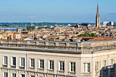France, Gironde, Bordeaux, area listed as World Heritage by UNESCO, view of the old town with the bell tower of the Saint-Michel Basilica from the rooftop of the Grand Hôtel