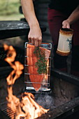 Locally caught salmon cooked over a flame with spruce twigs, Finland
