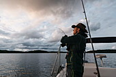 Local fisherman casts a reel in the Hummelfjärden waters of the inner archipelageo, Finland