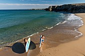 France, Morbihan, Peninsula of Quiberon, Quiberon, couple on paddle in the wild coast
