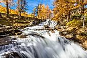 France, Hautes Alpes, Brianconnais in fall, Claree valley, Fontcouverte hamlet, Fontcouverte waterfall