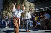 France, Ariege, St Girons, Autrefois le Couserans, scene of life during the days of rural animations on the old jobs of yesteryear in the Couserans, folk parade in the streets of StGirons