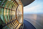France, Finistere, Ouessant, Armoric Natural Regional Park, Ponant island, The rotation of the huge Fresnel lens of the Creac'h lighthouse, Historical monument classified