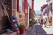 France, Pyrenees Atlantiques, Saint Jean Pied de Port, street of the citadel, backpack, shoes and pilgrim stick
