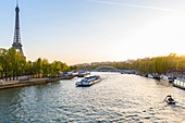 France, Paris, area listed as World heritage by UNESCO, the Eiffel Tower and a boat