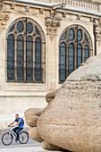 France, Paris, Les Halles district, sculpture Ecoute (1986) by the French artist Henri de Miller with the Saint Eustache church (17th century)