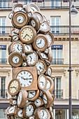 France, Paris, Cour du Havre, parvis of the Saint Lazare station, sculpture by the French artist Arman, L'Heure de tous (1985), composed of an accumulation of bronze clocks
