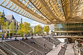 France, Paris, the canopy of the Forum des Halles made of glass and metal, designed by Patrick Berger and Jacques Anziutti and inaugurated on 5 April 2016, and the church of Saint Eustache