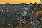 France, Lot, listed at Great Tourist Sites in Midi Pyrenees, Rocamadour, Natural regional park Causses du Quercy, listed as World Heritage by UNESCO, last rays of sun on the village and the sanctuary