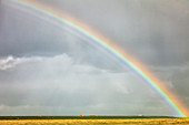 Rainbow with stormy mood, Eiderstedt peninsula, North Frisia, Schleswig-Holstein, Germany