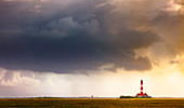 Westerhever lighthouse in stormy mood, Eiderstedt peninsula, North Frisia, Schleswig-Holstein, Germany