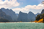 Drive over the Ratchaprapha lake with high karst rocks in the Khao Sok National Park, Khao Sok. Thailand