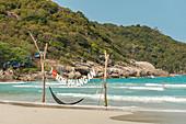 """I love Koh Phangan"" Schlld and hammock on Haad Rin beach in the south, Koh Phangan. Thailand"