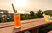 Sunset cocktails over Mae Haad Beach, Koh Phangan. Thailand