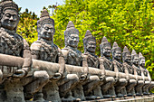 Temple guardian stone statues at pass road in the south of Koh Phangan. Thailand