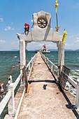 Long jetty into the sea at Wat Koh Phayam temple, Koh Phayam. Thailand