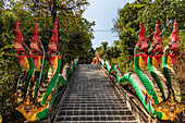 Stairs with colorful beats to the upper part of Wat Koh Phayam temple, Koh Phayam. Thailand
