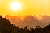 View of sunset over landscape from Tiger Cave Mountain, Tiger Cave Temple, Krabi Town, Thailand