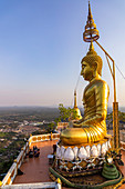 Buddha statue in the evening light on Tiger Cave Mountain, Tiger Cave Temple, Krabi Town, Thailand
