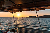Diving boat at sunset on the waters around Phuket. Thailand