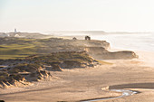 """View over dunes and beach """"Praia d'El Rei in the evening light, Amoreira, Portugal"""