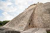 Pyramid of the magician in ancient Maya city Uxmal, Yucatan, Mexico