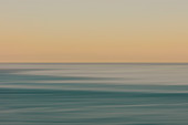 View of ocean, horizon and sky at dawn, blurred motion, northern Oregon coast