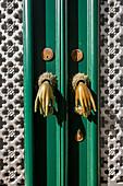 Door knockers in the form of hands, Algarve, Portugal